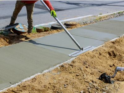Concrete sidewalk along a road