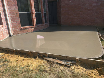 Recently finished concrete patio attached to a family home